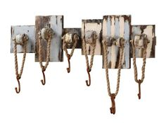 Rope Wall Hooks. A rustic beach accent for the lakehouse or beach house. Varied sizes of wooden planks are weathered and painted by hand. Metal hooks hang from rope to keep  hats, keys, towels and leashes within easy reach. Each will be unique.