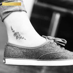 Minimalistic floral tattoo