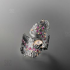 "Ring | Margisa Jewellery.  'Delicate feather"" Navette diamond and rubies  || http://margisa.eu/caten/1/rings.htm"