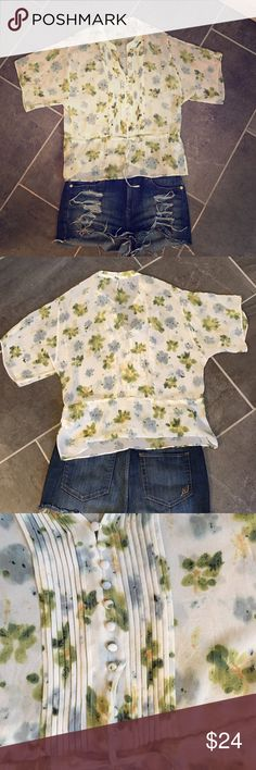 Floral sheer top! Really pretty and elegant! Floral top! Super cute! Only wore a couple times! Great for casual or work too! Banana Republic Tops Tunics