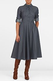 Our stretch cotton poplin dress is capped with a smart, banded collar and ties at the neckline, while the fitted waist tops the full circle skirt that gently swishes as you move.
