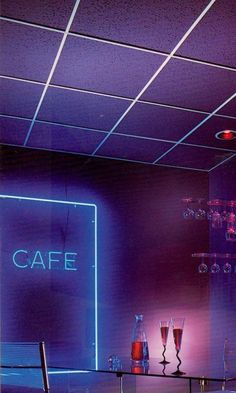 cool blue neon, black and white drop ceiling, lucite glass holder, Giandomenico Belotti's 1979 spaghetti side chair.