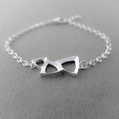 Silver triangle bracelet - handmade silver bracelet the effect gift for her. Geometric design hand carved in wax then cast in silver using the lost wax technique. It's multi-faceted surface reflects the light