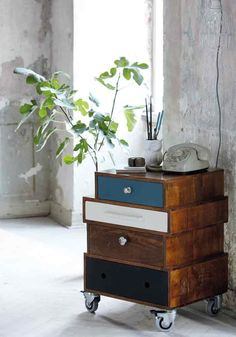 Wooden side table on wheels