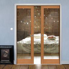Double Pocket Montana Fuji 1 Pane Oak sliding door system in three size widths with clear glass. #glazeddoors #internaloakdoors #pocketdoors