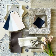 Pair cool grays and rich navy blue with bright whites, a touch of pink and brass accents to create a look that's modern, yet soft. This palette from designer Amanda Malson exudes contemporary sensibilities wrapped in comfort
