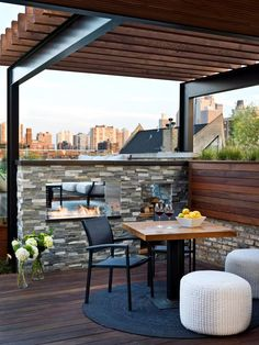 A steel and wood pergola is pitch perfect for this urban setting. Overlooking the Chicago skyline, the contemporary rooftop deck blends clean lines with rustic and industrial elements.
