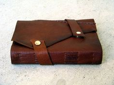 You can make this with recycled leather, pretty cool.....Make your own MEDIEVAL LEATHER JOURNAL by winterolive on Etsy, $5.00