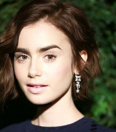 "Lily Collins: ""I don't use foundation, just concealer and a reflective blusher for glowing cheeks."" She added, ""Lancôme's UV Expert SPF 50 ($39) is..."
