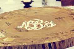 Guest 'Log' -  a unique alternative to the wedding guest book.  Paint monogram in the middle, have guests sign with sharpies.  Makes a beautiful rustic keepsake!