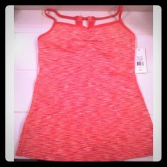 NWT Lucy heart center cami size medium Color is different shades of orange with built in bra. Material is 88% nylon and 12% spandex. Inserts included for the bra. Lucy Tops Tank Tops