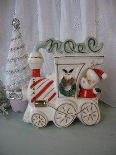 Hey, I found this really awesome Etsy listing at https://www.etsy.com/listing/212997939/vintage-santa-train-planter-christmas