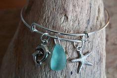 Seaglass Bracelet, Adjustable Bangle, Starfish Charm Bangle, Dolphin Bracelet, Sea Glass Jewelry, Nautical Jewelry, Beach Bracelet, Surfer by CoppertopRainbow on Etsy https://www.etsy.com/uk/listing/537436029/seaglass-bracelet-adjustable-bangle