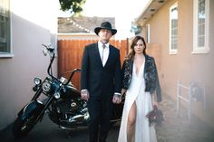 A lace Reformation bridal gown, a groom in a bolo tie and a motorcycle made for the perfect wedding day portraits of this Southern California bride and groom.