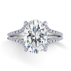 Danhov pave diamond double shank engagement ring mounting for an oval cut center diamond with diamond prongs.