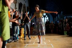 """First Lady Michelle Obama plays hopscotch during the """"Make A Difference"""" program at the University of Mumbai in Mumbai, India, Nov. 6, 2010. Most iconic Pete Souza photos of Obama family's first 4 years in the White House"""