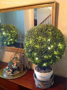 Bring the Boxwood Topiaries indoors in your foyer and enjoy their beauty and twinkling LED lights.