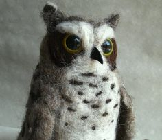 I needle felted this great horned owl from heritage breed Navajo-Churro wool. He stands about 6 1/2 inches tall. He has glass eyes and I