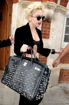 Lady Gaga:  she's just not a pretty girl.  But she's got a smokin' body, and a talent for maximizing what she's got.  And fuck you attitude in spades, natch.  (A MASSIVE Birkin?  With studs, even?!)