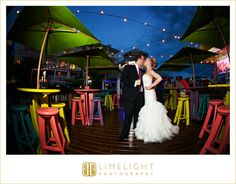 I love the colors of the tablesOn the Sunset Pier Ocean Key Resort Key West Wedding