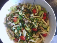 Chicken feta spinach sausage with sauteed asparagus, yellow squash, zucchini, tomatoes, parmesan cheese and penne pasta.