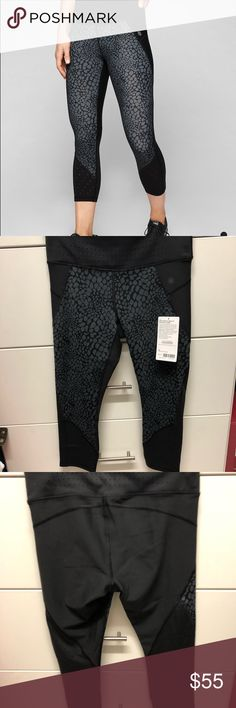 """NWT Athleta Stealth Crocodile Tru Cool Capri Brand New Athleta Stealth Crocodile Trucool Capri with Sculptek. Design on front Back is solid black. Never end drawstring for a fully adjustable fit. Performance High Rise. Inseam 19"""". Smoke and pet free home. Athleta Pants Track Pants & Joggers"""