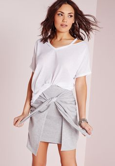 We're going Tee Total by going back to basics in this plain white T-Shirt. Featuring cut out shoulders and breathable fabric, this'll be perfect for the transitional period from winter to spring. Team with skinny jeans and sandals or barely...