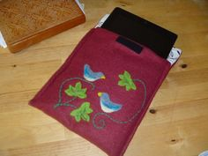 Padded needle felted iPad cover with a bird by AntimonyPrints, £12.00