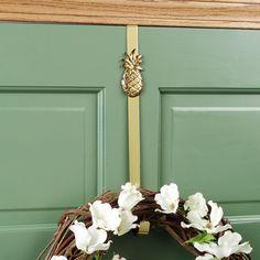 Pineapple - symbol of hospitality.  Door wreathe hanger.
