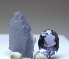 """IOLITE - Cordierite (mineralogy) or iolite (gemology) is a magnesium iron aluminium cyclosilicate.  Iron is almost always present.   As the transparent variety iolite, it is often used as a gemstone. The name """"iolite"""" comes from the Greek word for violet."""