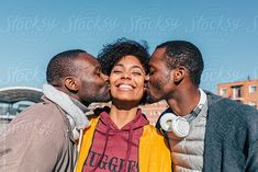 Stocksy United – Royalty-Free Stock Photos – Two men kissing her happy friend by VICTOR TORRES