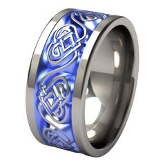 The Guinevere color anodized, titanium wedding band was created to be a powerful piece of wearable expression. The Guinevere ring was designed to symbolize a woman who naturally embodies goodness and purity. This ring is 8mm wide or more, to better show the graceful Celtic knot pattern. This ring allows further personalization by adding a rich tone, or featuring two or more shades in the same ring, to make it uniquely yours. Crafted from a solid block of aircraft grade titanium, it is very…