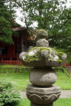 Beautiful moss-covered jinja (shrine) in Japan