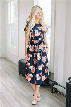 You can never have too many of our soft and comfy floral pocket dress! This navy dress features a pretty pink and red floral print, has an elastic waist, short sleeves, and adorable front pockets!