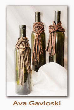Using bronze Powertex on an assortment of t-shirts, lace doilies, burlap and cord,    Ava created these wonderful wine bottle cuffs. ...