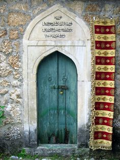 Teal door in Mostar, Bosnia