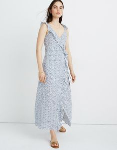 Trimmed in soft ruffles, this faux-wrap floral maxi dress has a sexy '70s feel. With a flattering fitted waist complete with tasseled ties, it's a leg-baring style made for wedding guest duty.