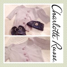 BOGO free!  Charlotte Russe Sweater Adorable Charlotte Russe knitted sweater with crochet embroidered snap buttons. Very cute with jeans or a skirt. Gently worn and no signs of any marks or stains. Fits is woman small.    🌾👑. 👗💫🌾👑.  (Be sure to ask about our BOGO FREE offer!!  Look for details listing in closet!) Charlotte Russe Sweaters Cardigans
