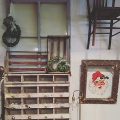 Love this Chippy, painted cubbie and oversized farm window along with the traditional Vintage Santa.