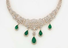 Gold and Diamond jewellery designs: gitanjali jewels beautiful diamond emerald jewelle...