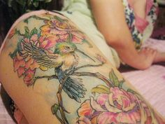 Watercolor(?) flower and bird tattoo
