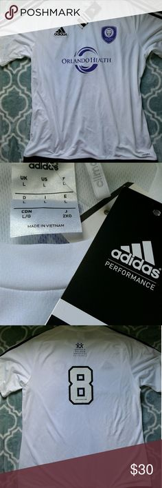 Adidas Orlando Soccer Jersey Brand new with tags white with black stripes Adidas Soccer Jersey with Orlando city and sponsors size Large, 3 available. Thanks for looking!! Adidas Shirts