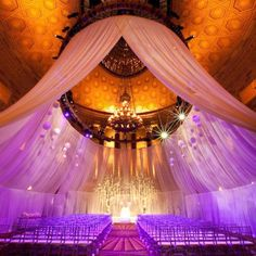 """Why We Love It:We love how the fabric draping gives this massive ballroom a more intimate feel.Why You Love It: """"LOVE IT!!!! HEAVEN ON EARTH!! YESSSSSS LORD THANK YOU JESUS!!!!!""""—Kimberly R. """"I love this! Oh Oh Oh I am speechless!"""" —Hazel H.  """"This does give that wow effect.""""—Rosetta K. """"What a venue, stunning!""""—Paper Memories """"This is so beautiful, it kind of make me want to have a bigger wedding.""""—Kimberly W.Photo Credit: Shira Weinberger Photography/Created by:Tantawan Bloom"""