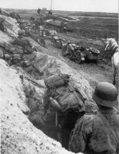 Somewhere on the Eastern Front, a mechanized column pauses. Quick foxholes for everybody.