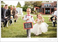 Here comes the bride! Flower girl and ring bearer | Sunnyside Country Club Wedding in Waterloo, Iowa