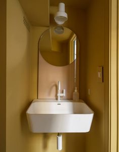 A Luminous, Euro-Style Row House in Washington, DC, Courtesy of Studio Oink (Remodelista: Sourcebook for the Considered Home) Yellow Bathroom Decor, Yellow Bathrooms, Commercial Interior Design, Commercial Interiors, Apartment Interior Design, Bathroom Interior, Interior Paint, Tiny Half Bath, Creative Walls