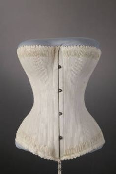 Wedding Corset Made Of Cotton Twill And Silk Thread Embroidery  c.1887 - Worn By Miss Honore O'Shea, Daughter Of James J. O'Shea And Honore Pyne O'Shea, Whe She Married Donor's Father, John J. Sullivan  November 10, 1887 At Holy Family Church, Roosevelt And May Street, Chicago, Illinois