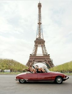 Citroen DS and a bunch of people in Paris