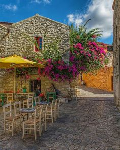 Areopolis~Lakonia~Greece Beautiful Places In The World, Oh The Places You'll Go, Places To Visit, Amazing Places, Greek Flowers, Places In Greece, Sidewalk Cafe, Outdoor Cafe, Peaceful Places