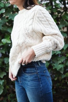 White coat-knitted jumper & ripped jeans